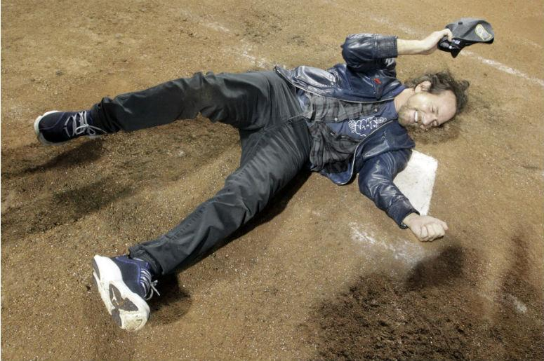 Recording artist Eddie Vedder celebrates on home plate after the Chicago Cubs defeated the Cleveland Indians in game seven of the 2016 World Series at Progressive Field