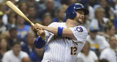 Brewers to open season with Vogt on DL