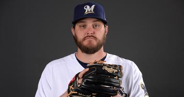 Brewers' pitchers Miley, Logan suffer injuries