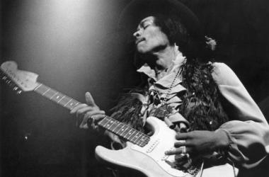 Jimi Hendrix performs on his Fender Stratocaster electric guitar at the Fillmore East in New York.