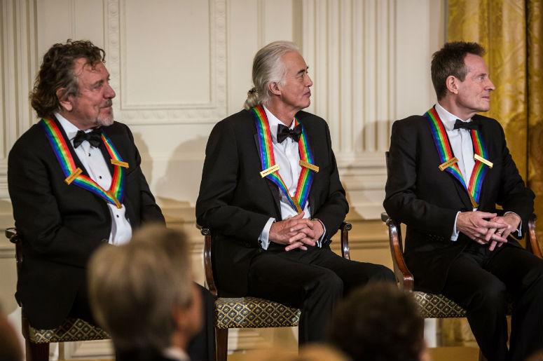 Robert Plant, Jimmy Page, and John Paul Jones (L-R) of the band Led Zeppelin attend the Kennedy Center Honors reception at the White House on December 2, 2012 in Washington, DC