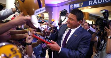 LSU head coach Ed Orgeron signs autographs for fans during SEC media days at Hyatt Regency Birmingham-The Winfrey Hotel