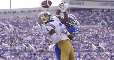 UCLA Bruins wide receiver Jordan Lasley (2) attempts to catch a pass against Memphis Tigers defensive back Terrell Carter (2) during the second half at Liberty Bowl Memorial Stadium. Memphis Tigers defeated the UCLA Bruins 48-45.
