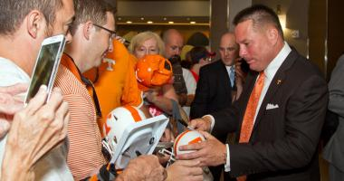 Tennessee Volunteers head coach Butch Jones signs autographs for fans during the SEC Football Media Days at the Wynfrey Hotel.