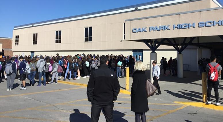 Hundreds of students gather outside at Oak Park High School as part of a nationwide walkout on Wednesday