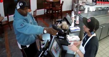 Man points a gun at a Jimmy Johns employee