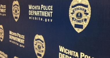 Wichita Police search for suspect who shot at an officer at Warren East