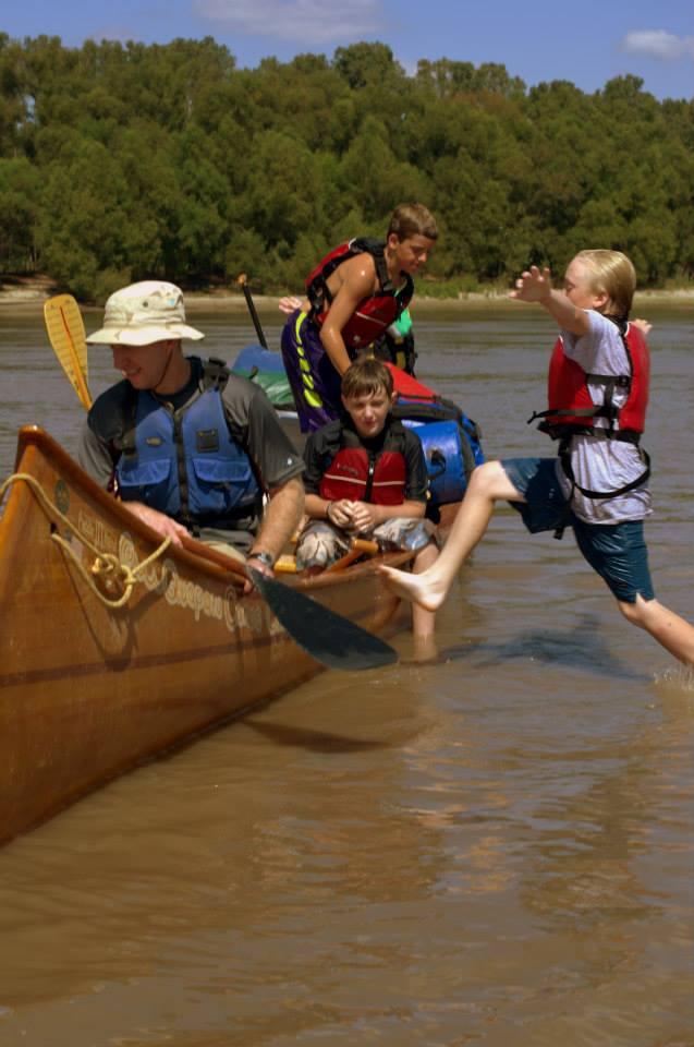 http://mailman.305spin.com/users/island63/images/kids/canoe swim.jpg
