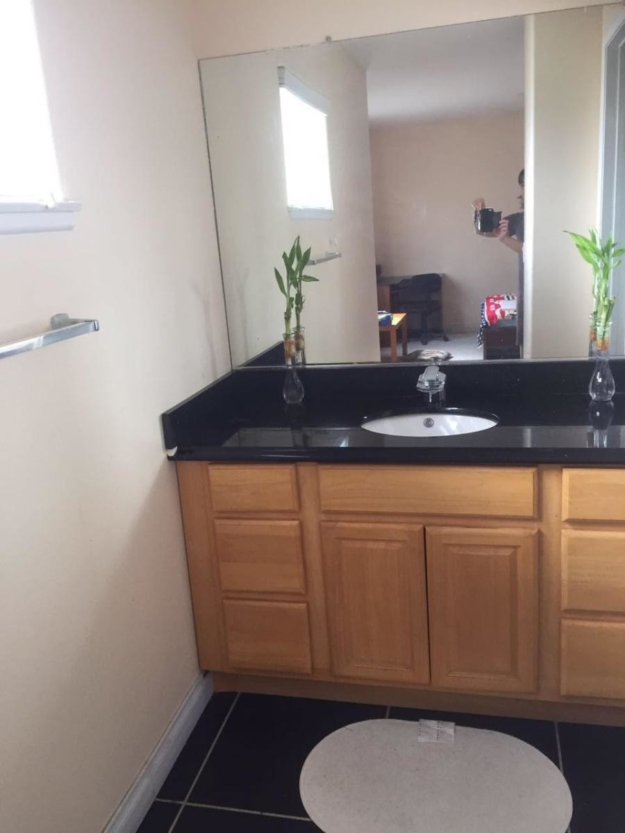 Spacious master bedroom with private bathroom in Pasadena townhome for rent.