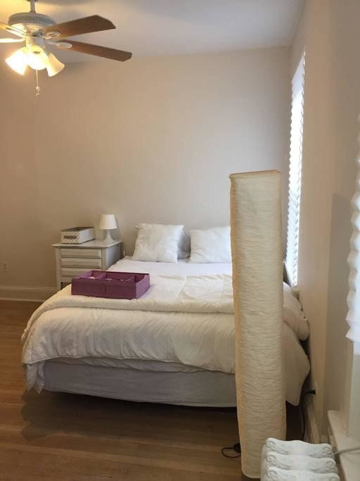Queen size bed in a room for rent