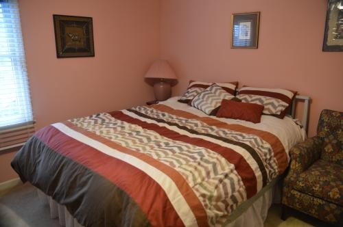 Private furnished bedroom with private bathroom