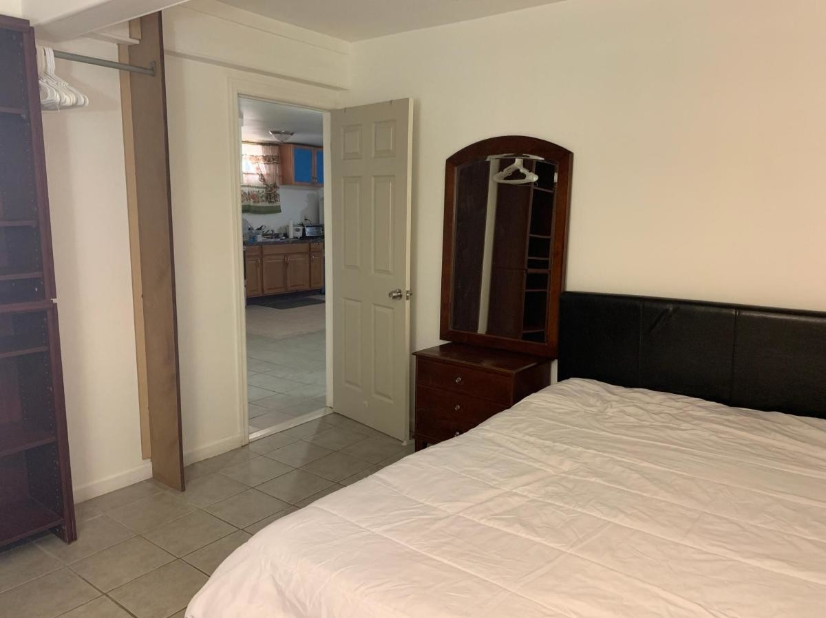 One furnished room in a three-bedroom apartment