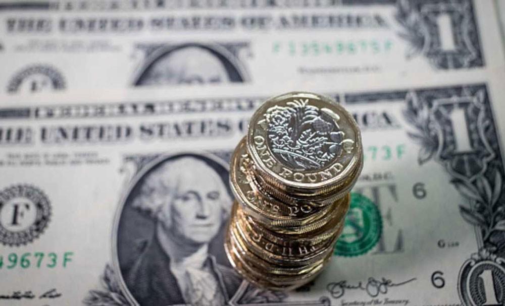 استقرار الدولار والإسترليني بأعلى مستوى في عام