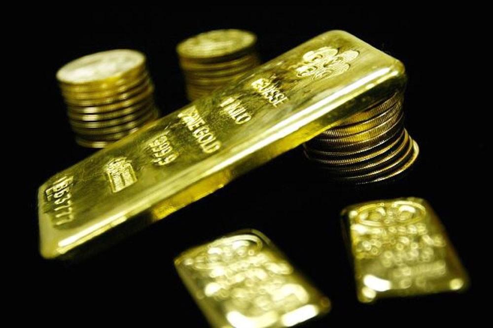 الذهب يتراجع مع عودة الدولار للصعود