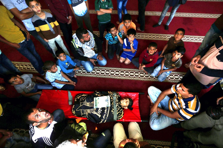 غزة تلملم جثثها.. وواشنطن تعرقل طلباً أممياً للتحقيق