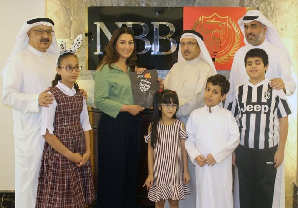 بنك البحرين الوطني يوزع كوبونات على جمعية الصداقة للمكفوفين