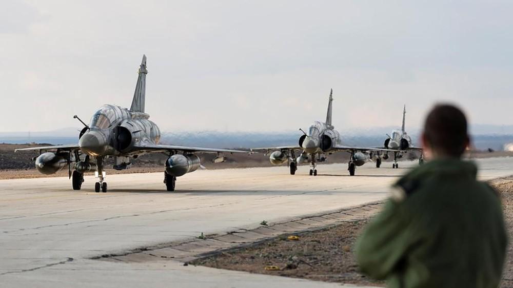 فرنسا: مستعدون لضرب أهداف سورية إذا اُستخدم الكيمياوي