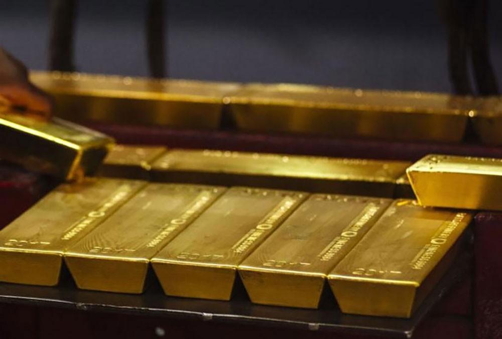 الذهب يتماسك فوق 1400 دولار