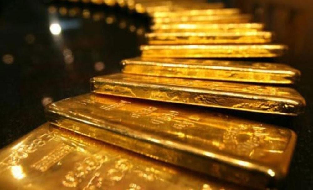 الذهب يهبط 1% بفعل تعليقات باول وتحسن شهية المستثمرين