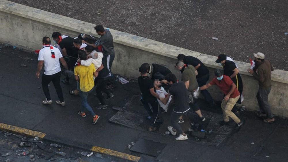 قنابل تخترق جماجم متظاهري العراق.. ومنظمة العفو تدين