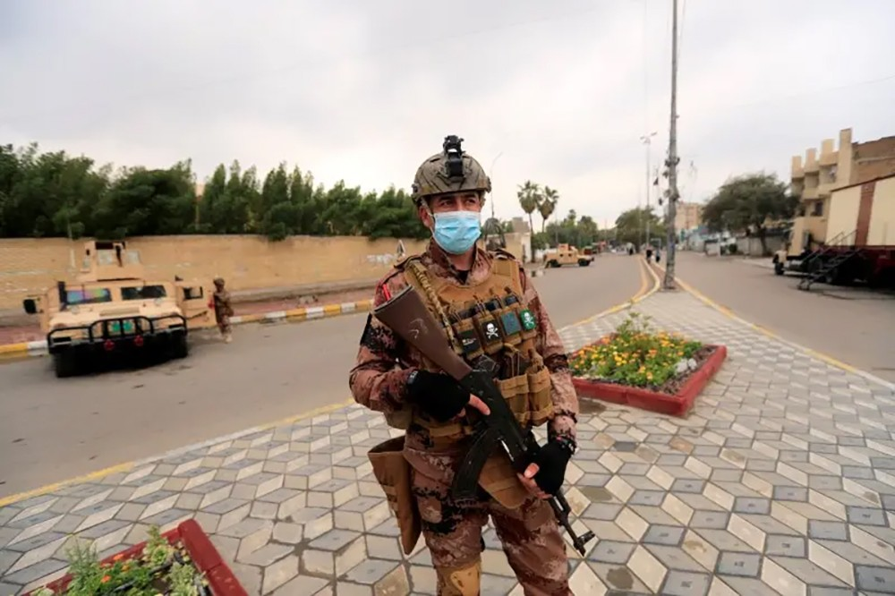 العراق: سنعتقل من يخالف حظر التجول