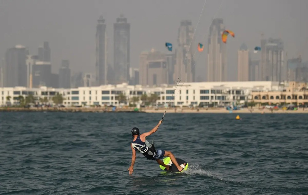 An athlete kite-surfs during the Dubai watersport festival, organised by the Dubai International Marine Club (DIMC), in the Gulf emirate on June 26, 2020. (AFP)