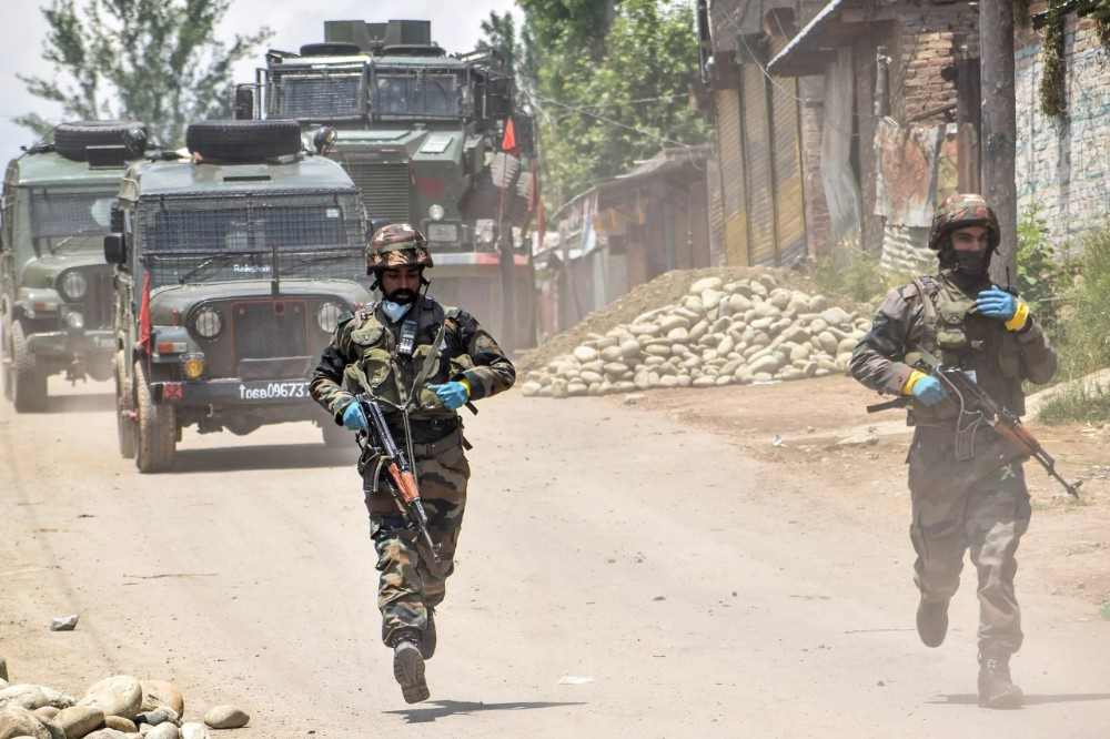 Security personnel run patrolling near the site of a gunbattle in Kangan area of south Kashmir's Pulwama district on June 3, 2020. (AFP)