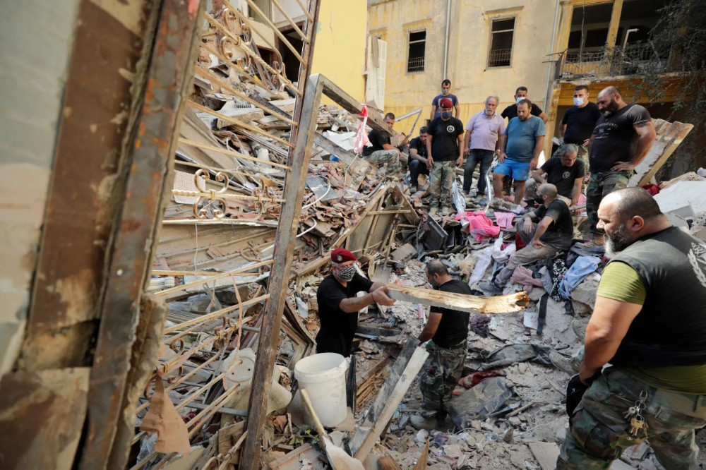 Lebanese soldiers search for survivors after a massive explosion in Beirut, Lebanon on Aug. 5, 2020. (AP)