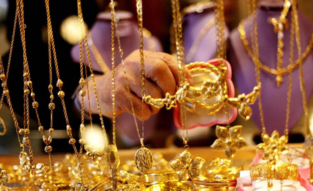 الذهب يستقر مع تماسك اليوان الصيني