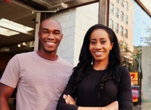 Two people smile - photo from the cover of Financial Health Network Report