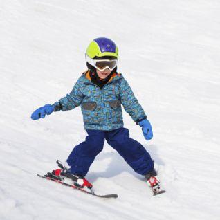 Little Boy learning to ski in Lech, Austria
