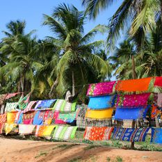 Colourful sarongs on beach, Mozambique, Africa