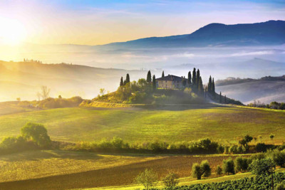 Sunrise over a hill in Tuscany