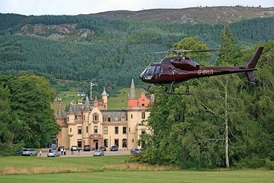 A helicopter landing outside exclusive use property, Aldourie Castle