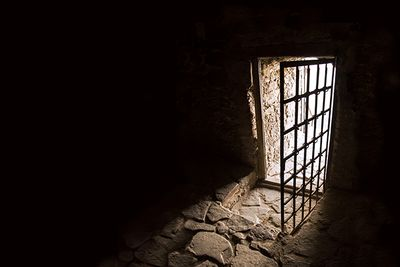 A picture of an open jail door