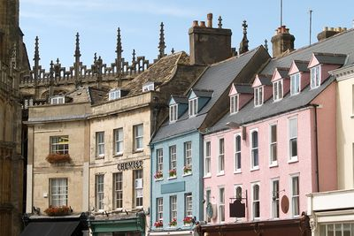 An image of the coloured houses in Cirencester, Cotswolds
