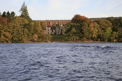 A picture of Aldourie Castle, take from Loch Ness
