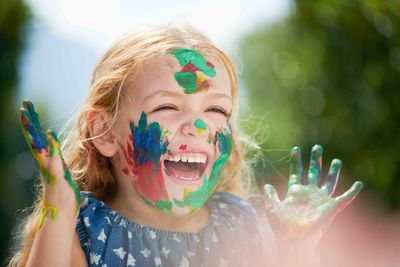 laughing girl with paint on her face