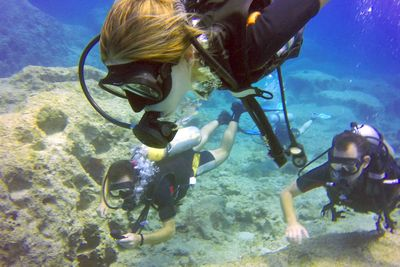 young girl scuba diving