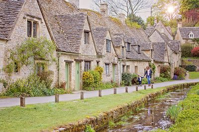 Mum & daughter walking in a Cotswolds village