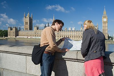couple with a map outside Westminster Abbey
