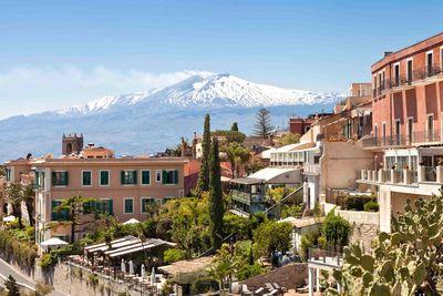 sicilian village and volcano