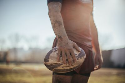 a rugby ball in hand