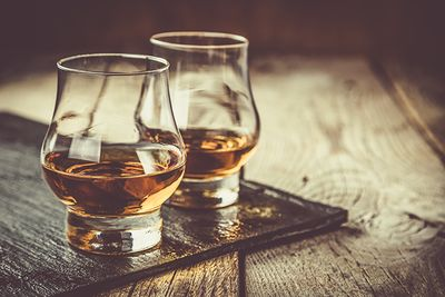 whisky glasses on a wooden table