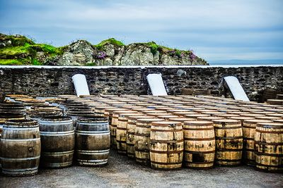 whisky barrels stored outside