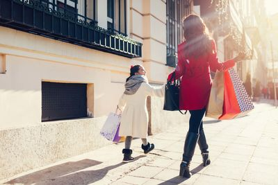 a mother and young daughter shopping