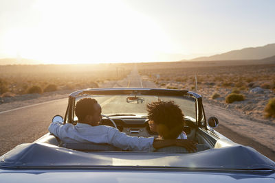Couple in Car During Sunset