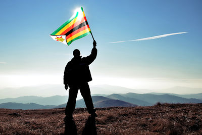 flying zimbabwe flag