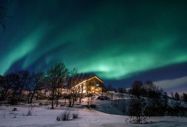 The Northern Lights over Kirkenes Snowhotel