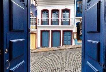 Blue Doorway to Cobbled Street